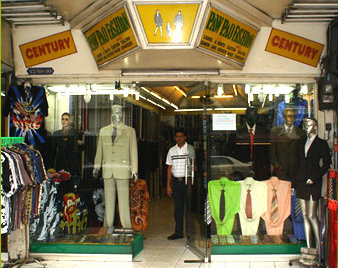 In Phuket, a Thai Tailor beckons from every doorway.